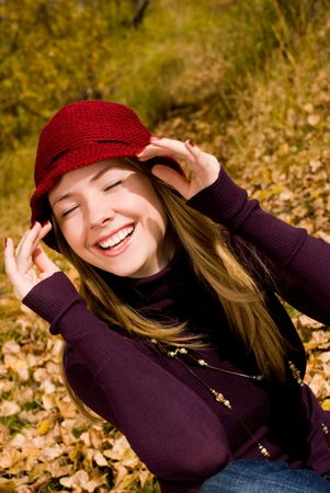 careless: pretty laughing girl in the park Stock Photo