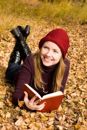 beautiful girl reading a book in the park photo