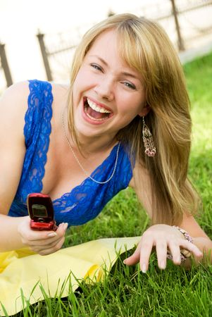 laughing girl with a cell-phone photo