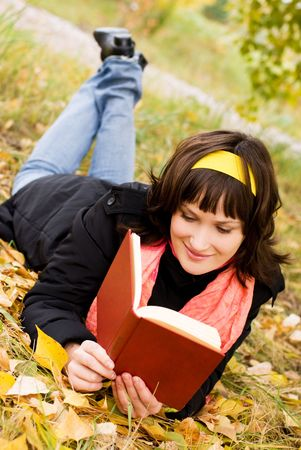 pretty girl reading a book in the park Stock Photo - 3780718
