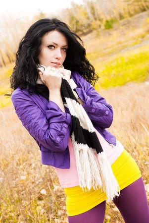 beautiful melancholic brunette girl in the park photo