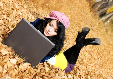 pretty brunette girl with a laptop outdoor Stock Photo - 3784060