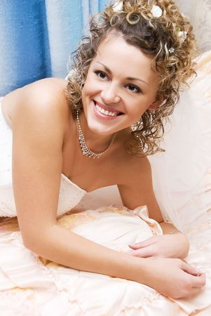pretty young smiling bride at home photo