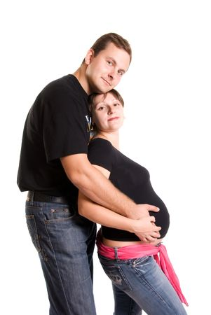 young pregnant woman and her husband  photo