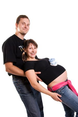 happy pregnant woman and her husband having fun isolated against white background photo