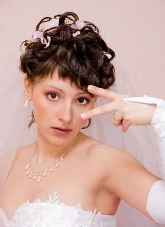 portrait of a beautiful playful bride photo