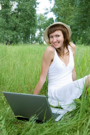 beautiful girl with a laptop photo