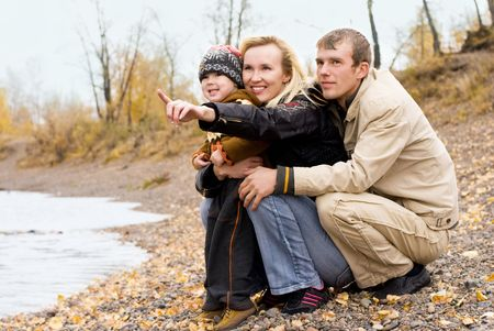 happy family having fun by the lake Stock Photo - 3784178