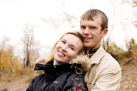 happy cheerful young couple outdoor photo