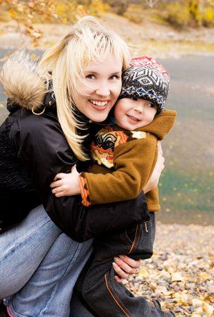 ourdoor: happy beautiful mother and her son outdoor Stock Photo