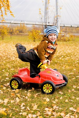 cute little boy playing with his car outdoor Stock Photo - 3784214
