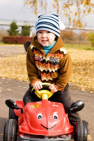 cute little boy playing with his car outdoor Stock Photo - 3784188