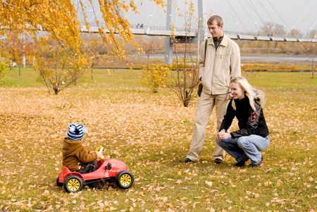 happy mother and father playing with their son outdoor Stock Photo - 3784215