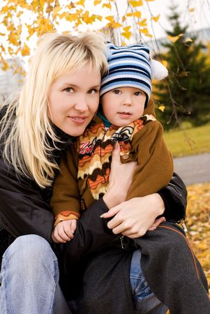 happy beautiful mother and her little son outdoor photo