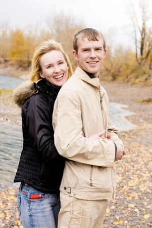 happy laughing young couple outdoor photo