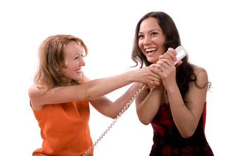 two girls taking on the phone with someone photo