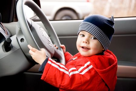 two year old: two year old little boy driving a car