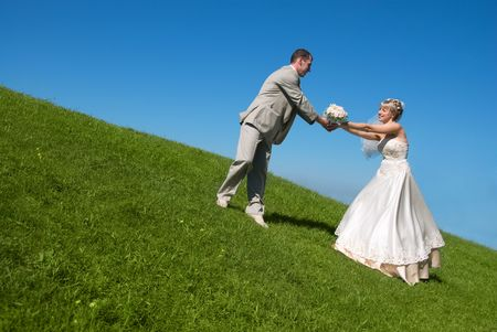 happy bride and groom outdoor on the hill Stock Photo - 3808693