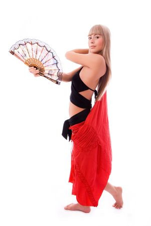 showbusiness: beautiful young blond woman dancing with a fan isolated against white background Stock Photo