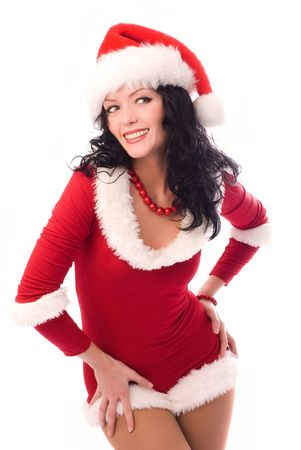 beautiful sexy brunette woman dressed as Santa isolated against white background photo