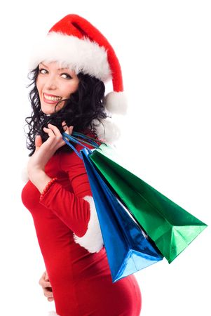 sexy brunette girl dressed as Santa carrying shopping bags with Christmas presents Stock Photo - 3824721