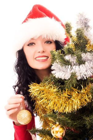 beautiful smiling brunette woman dressed as Santa decorating a Christmas tree photo