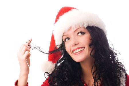 portrait of a coquettish sexy brunette woman wearing Santas hat photo