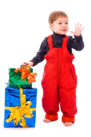 cute two year old boy with a lot of presents photo