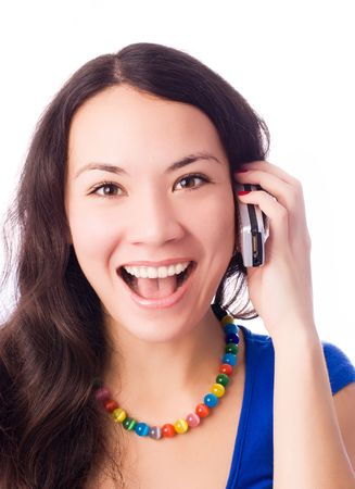 happy excited young brunette woman talking on the cell-phone photo
