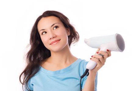 beautiful smiling brunette girl with a hairdryer in her hand photo