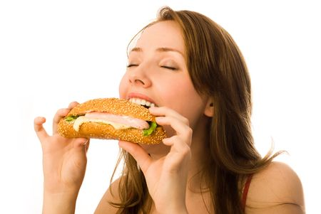 adult sandwich: beautiful young woman eating a hot-dog isolated against white background Stock Photo