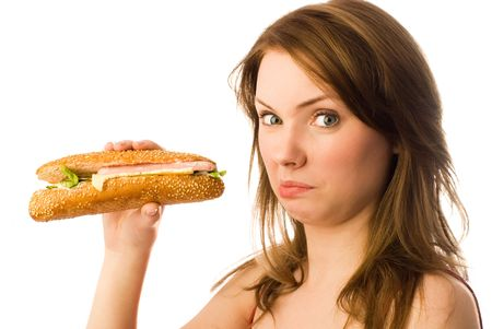 beautiful young woman shows her disgust to fast food photo