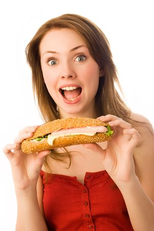 adult sandwich: surprised young woman with a hot-dog isolated against white background