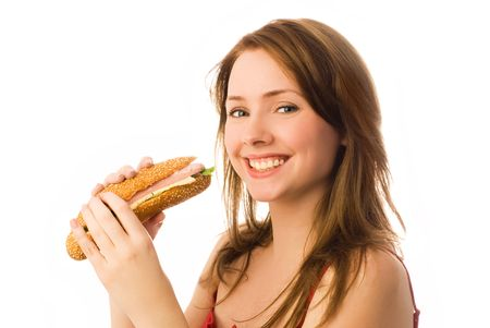 gains: happy young woman eating a hot dog isolated against white background