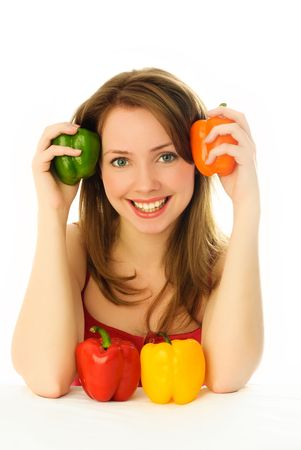 beautiful young smiling woman with colorful peppers photo
