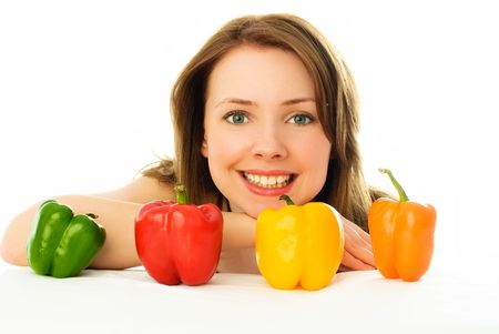 beautiful young woman with peppers isolated against white background photo