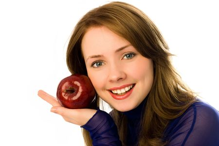 beautiful young woman with an apple isolated against white background photo