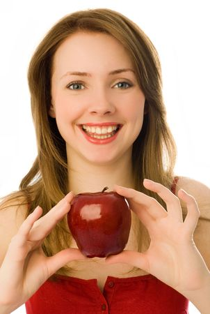 beautiful smiling young woman giving us a red apple photo