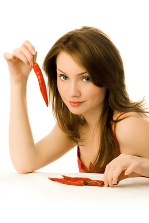 sexy young woman with red chili peppers isolated against white background photo