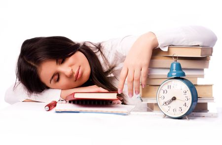 beautiful student falls asleep on the table while preparing for the test photo