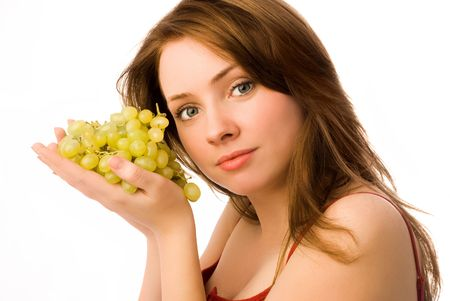 beautiful woman with grapes isolated against white background photo