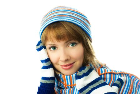 beautiful young ginger woman wearing a scarf, mittens and warm hat  isolated against white background photo