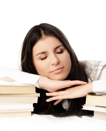 bore: beautiful young brunette student falls asleep on the table while doing homework Stock Photo