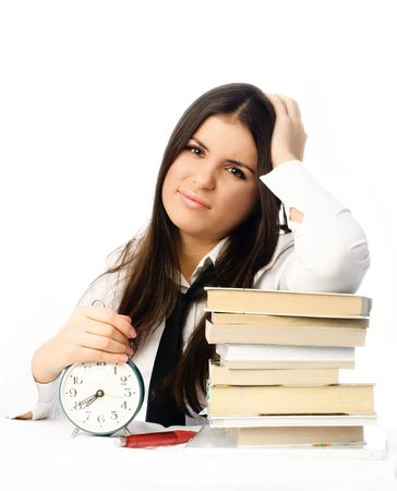 beautiful young brunette student sitting by the table and unwilling to do homework photo