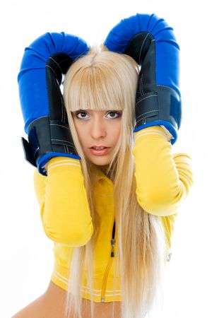 female sexuality: scared young blond woman wearing boxing gloves isolated against white background