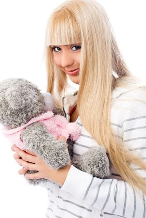 charming blond girl embracing her teddy bear isolated against white background photo