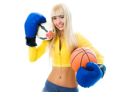 beautiful cheerful blond girl wearing boxing gloves and holding two balls in her hands photo