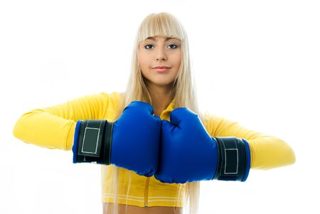 female sexuality: serious beautiful young blond woman wearing blue boxing gloves Stock Photo