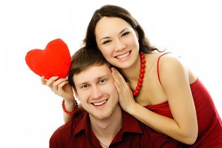 happy couple embrace isolated against white background photo