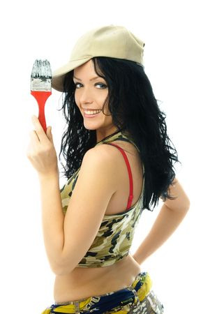 beautiful cheerful young brunette woman holding a brush in her hand photo
